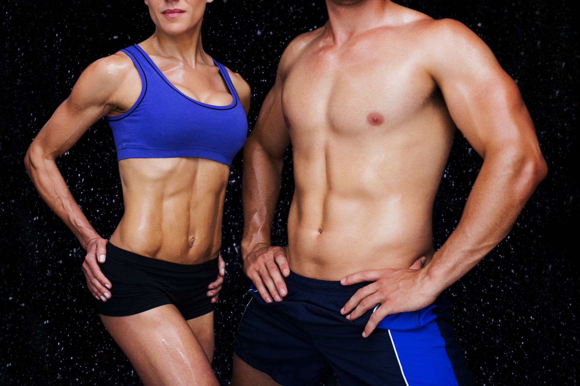 Bodybuilding couple against black background